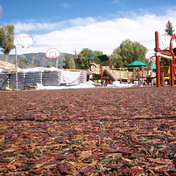 Tuff mulch bonded rubber surface is a recycled permeable - Playground surfaces for home ...